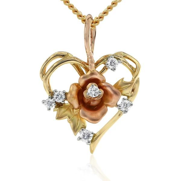 Celebrate the pure joy of nature with this delicate open heart pendant. Featuring the stunning Gerard McCabe Fleur de Lis rose at its centrepiece. This stunning heart is crafted in three tones of 18ct gold: White, yellow and rose, and accented with sparkling white diamonds. This pendant comes with an 18ct rose gold chain and measures 23mm long. Designed by Sabina Lee for Gerard McCabe.