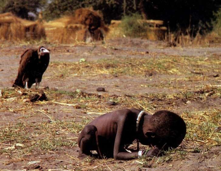 In 1993, photographer Kevin Carter won the Pulitzer Prize for taking this photo of a starving girl in South Sudan being stalked by a vulture. It was a rule for the journalists not to touch victims of the famine to avoid transmitting disease. Carter was so overcome with guilt that he committed suicide 3 months later.