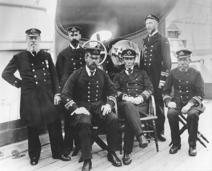 Officers of HMCS Protector, 14 September 1897, in front of one of the ship's 6-inch guns. Standing from left: Warrant Officer James White, Chief Gunner Edwin Argent, Lieutenant Patrick Weir; Seated: Chief Engineer William Clarkson, Captain William Creswell and Lieutenant Marshall Smith.
