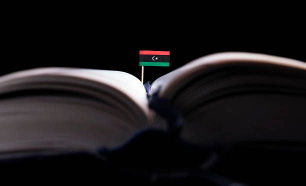 libyan flag in the middle of the book knowledge and education concept