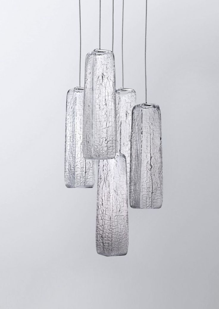 Yakisugi by Kengo Kuma for Lasvit _ The crackled texture of Kengo Kuma & Associates' new lighting collection for Lasvit was created by blowing molten glass into dry wooden moulds