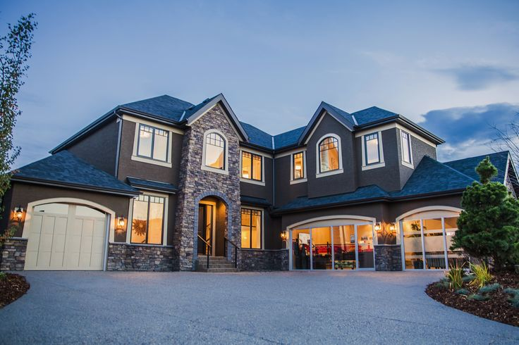 """New Home NOW AVAILABLE in Artesia at Heritage Pointe - 13 Waters Edge Drive. """"The Woodbridge"""" is a 3188 sq ft plan that has been awarded numerous accolades. Book an appointment with Cory cbaiton@astoriahomes.ca or Nadine nrobertson@astoriahomes.ca 403-237-6877"""