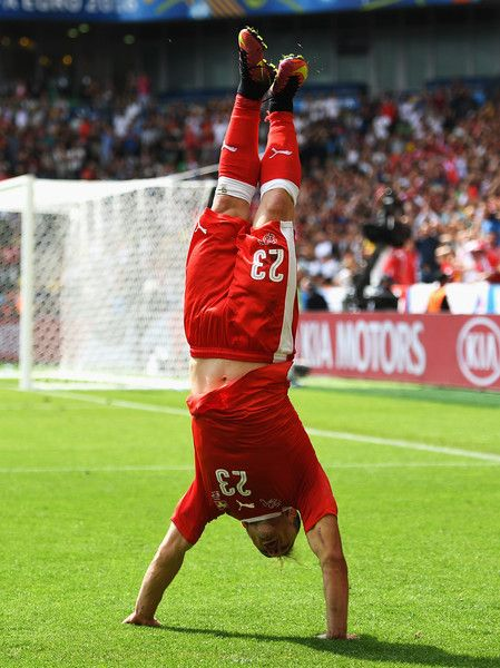 Xherdan Shaqiri of Switzerland celebrates scoring his team's first goal during the UEFA EURO 2016 round of 16 match between Switzerland and Poland at Stade Geoffroy-Guichard on June 25, 2016 in Saint-Etienne, France.