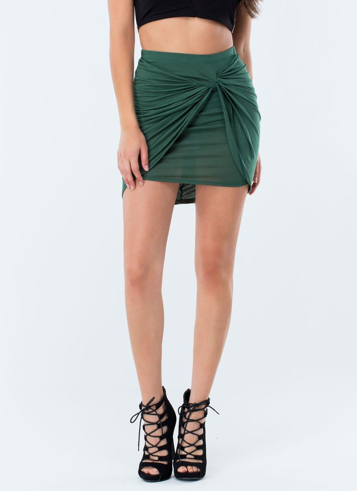Show off those long legs of yours with this knotted draped mini skirt.