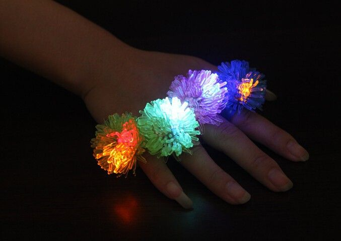 http://ru.aliexpress.com/item/Free-shipping-Cute-Fashion-LED-Color-Change-Flashing-Jelly-Soft-Finger-Ring-Non-toxic/32291719337.html