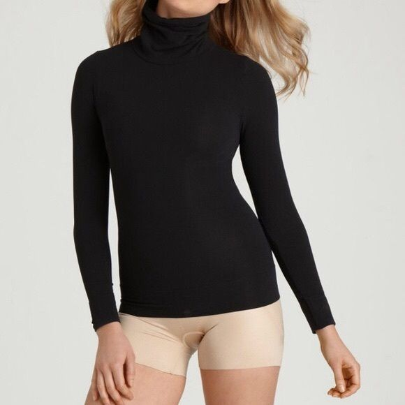 Best! SPANX On Top In Control Classic Turtleneck M On Top and In Control show off your shape and can be worn with everything from jeans to high-waisted skirts! This versatile fashion staple instantly takes your look from so-so to so-fabulous.  Velvety soft finish with a hint of shine  Keep arms firm with figure flattering sleeves. Can be layered or worn on top  62% Nylon and 38% Spandex/Elastane Shaping compression zones you can't see, but results you can! Ultra-comfortable composition and…