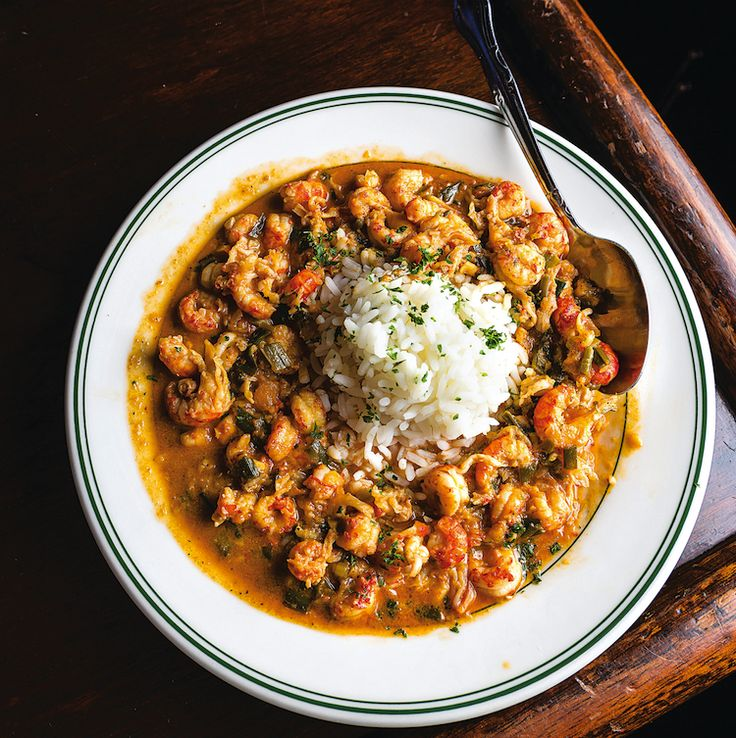 Crawfish Etouffée from New Orleans, Louisiana. Crawfish tails are cooked with tomatoes, paprika, and cream to make a luscious stew.