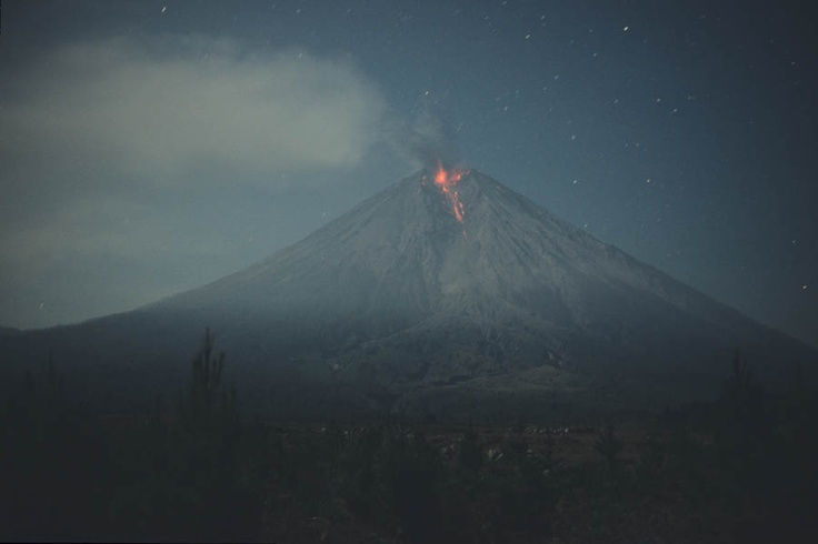 Nighttime view of summit eruption of Semeru Volcano.