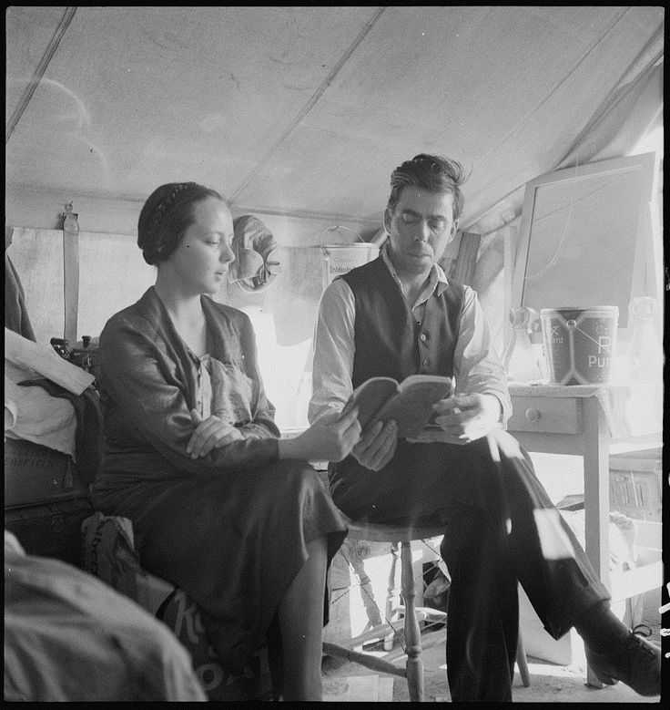 """Dorothea Lange. The Great Reaping Day. Hymn singing, Sunday afternoon. The woman had been """"saved"""" the week before. Oklahoma potato pickers. Kern County, California. 1937 Mar. Library of Congress Prints and Photographs Division."""