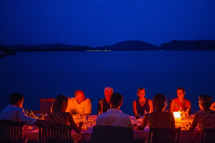 Guests having dinner beside the lake