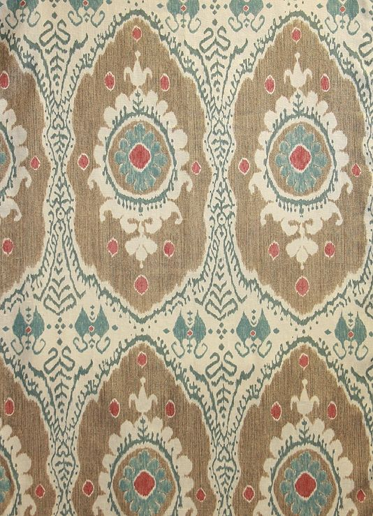 Bukhara Linen Fabric An ikat style printed linen in browns, teal and soft red printed on a cream linen
