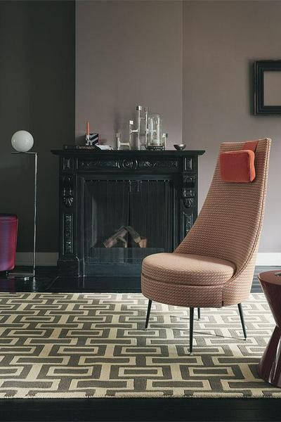 The Wedgwood Itaglio Grey Designer Wool Rug features a gorgeous pattern to add style to any living area.