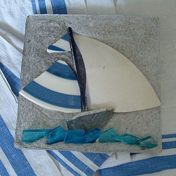 Broken-china sailboat.  Want to try it in glass!