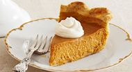 This pumpkin pie and its whipped cream topping are made with a splash of dark rum, making this American classic even more irresistible.