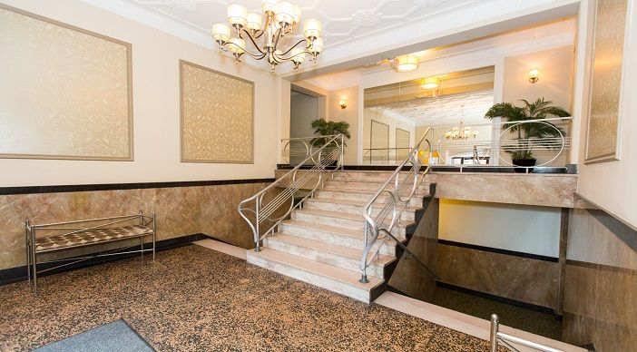 Inviting Lobby with Stone Detail and Unique Staircase   1401 Sheridan Apartments in Brightwood   WC Smith