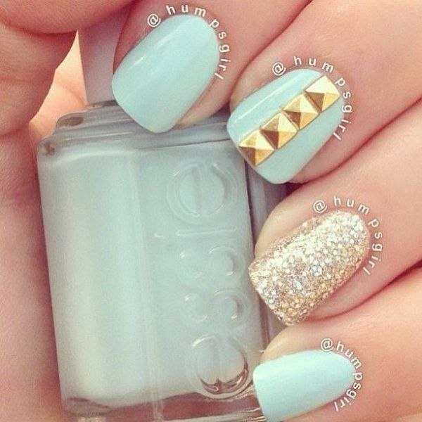 Dramatically sexy gold and turquoise nail art;