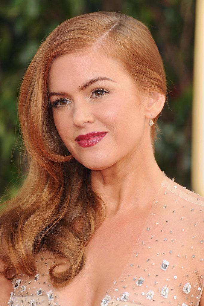 Isla Fisher: Stay tuned for our commentary on this gorgeous Golden Globes look.