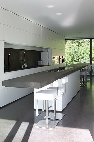 Minimalist kitchen inside the Perke House by Atelier d'Architecture Bruno Erpicum & Partners ( © Jo Pauwels) _