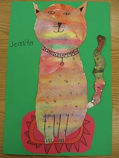 2nd graders first painted a paper with watercolor paints. They could make an abstract pattern or realistic (colors a cat really could be). The rest of that art class we worked on our rugs. The next day, they drew cats step-by-step on the back of their paintings. We cut them out and added details on the front with sharpies :)