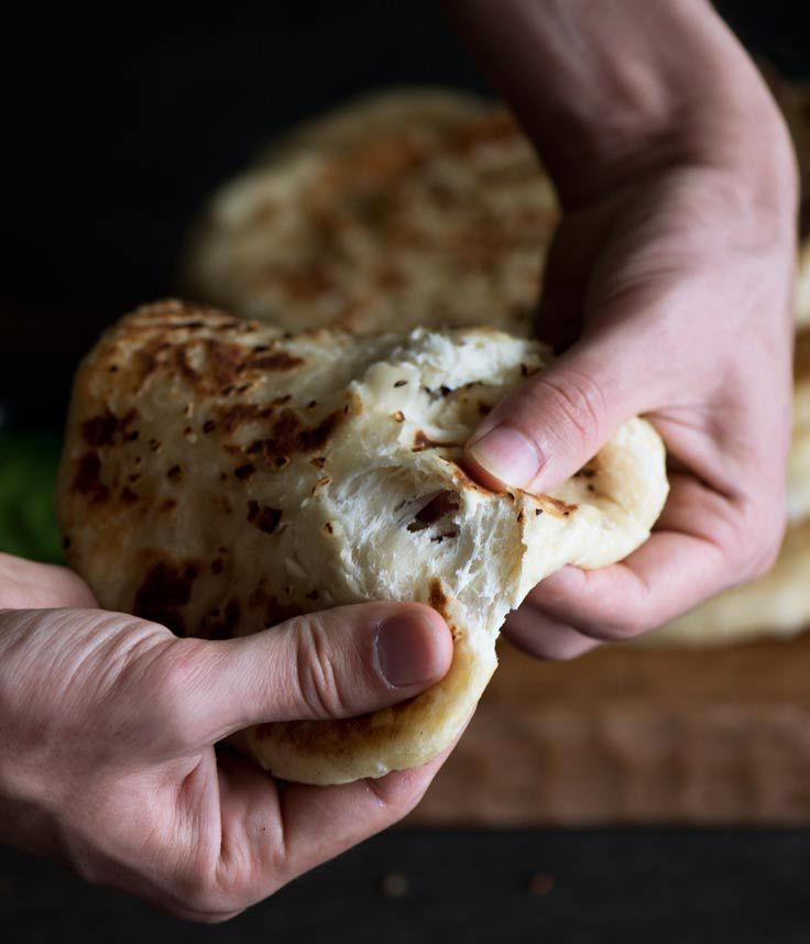 No Knead Garlic Cheese Naan - Amazing flavors of garlic and butter, crisp outside yet insanely soft, chewy with melting cheese inside.