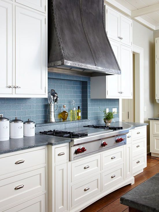 Love the white shaker style doors, blue backsplash and distressed hood. My kind of kitchen!