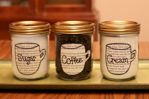 Want to make your coffee area look organized and pretty? Recycle your old jars into cute canisters for your sugar, cream, and coffee beans!