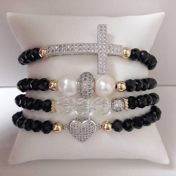 •6mm Black Rondelle Faceted Beads •Silver Filled, Cubic Zirconia Charms •6mm Gold Filled Beads •Assembled with 1.0mm elastic string. This is a cute set for any occasion and can be made to accommodate your wrist size. Make sure to specify your size at time of checkout. Small
