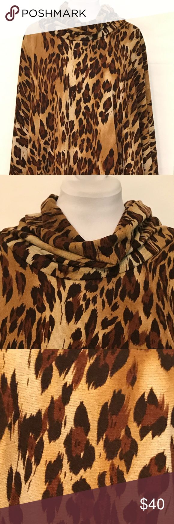 """Lapis Animal Print Cape Cowl Neckline Size Medium This is a cape by Lapis. Details include cowl neckline, medium length and animal print (jaguar?) Colors are brown, tan and cocoa. Fabric is 94% poly and 6% spandex. Size Medium. Length is 28"""", sleeve length is 25"""", and width measures 46"""". All color descriptions and measurements are approximate. In excellent condition. Lapis Jackets & Coats Capes"""