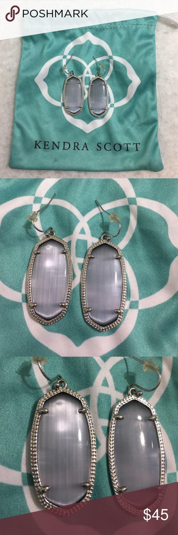 Kendra Scott Elle Earrings Kendra Scott Elle Earrings in Slate Cats Eye/Silver. Coloring goes with any attire you want to add silver earrings. Kendra Scott Jewelry Earrings