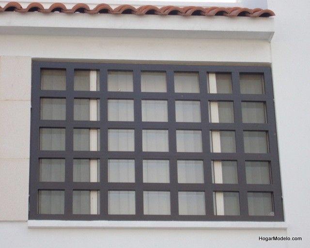 Fotografía de diseño de verjas de fierro de ventana contemporánea