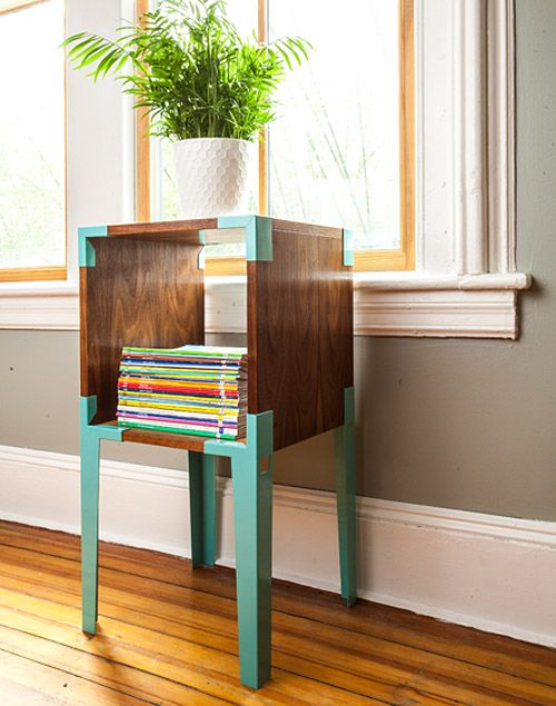 Pinning this for the colors. I love the teal contrasted with the dark wood. I'm thinking about how I plan to paint my coffee table teal. Maybe the wooden arms of the couch can get re-stained that dark brown for a similar look.