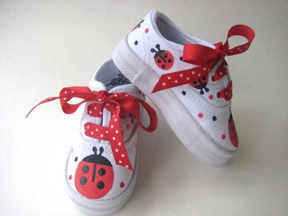 These girls ladybug shoes will make your little one smile! We hand painted little red ladybugs all around these white, cotton canvas kids