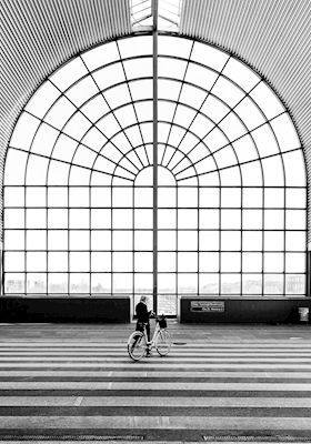 Big glass window with beautiful lines at a train station, a true piece of art. Captured by photographer Calle Artmark. Available as poster and laminated picture at printler.com, the marketplace for photo art.