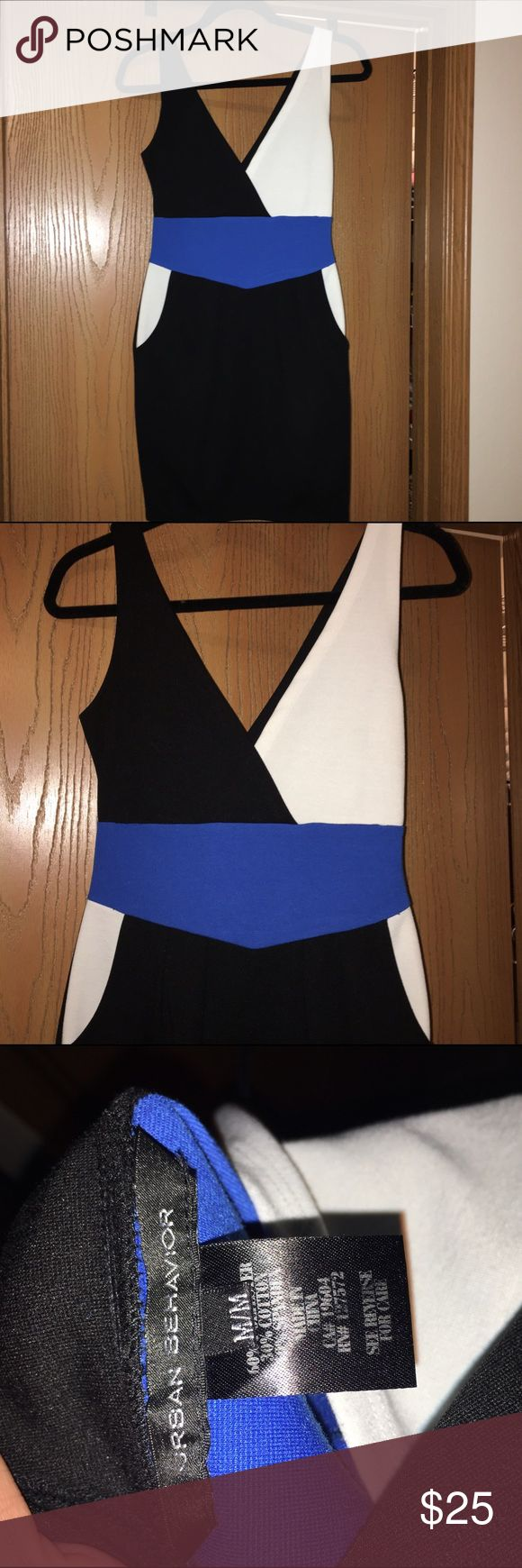 Urban Behavior Color Block Dress Black, white and blue color block dress. Two unnoticeable pockets in the front on either side. This is more of a midi dress but can be shorter depending on your height. Urban Behavior, size M. Worn once. Urban Behavior Dresses