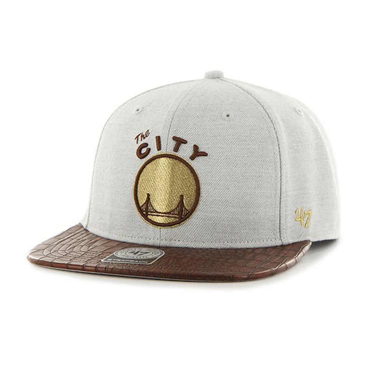 """Grab this 47 Brand Grey/Brown/Gold Golden State Warriors """"The City"""" Orinoco 47 Captain Cap! Go get it now at www.TheCapGuys.com. #goldenstatewarriors #47brand #orinoco #47 #captain #goldenstate #logo #snapback #basketball #hat #cap #gold #grey #warriors #swag #me #style #tagsforlikes #me #swagger #jacket #shirt #dope #fresh"""