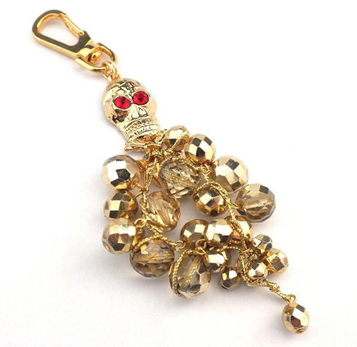 Skull pendant - goldtone glass beads & red rhinestones.
