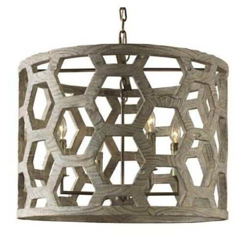 Available in four different finishes (Serrated Dolomite Silver not pictured)  Chain Length: 6'  The Taj Mahal inspired the signature design motif of the Angeline Chandelier. The tessellated hexagonal pattern that forms the body of the chandelier can be found on a carved sandstone panel at the Taj, one of the Seven Wonders of the World. This fixture is sure to elicit some wonder of its own.  Each piece is finished by hand by artisans and is unique.