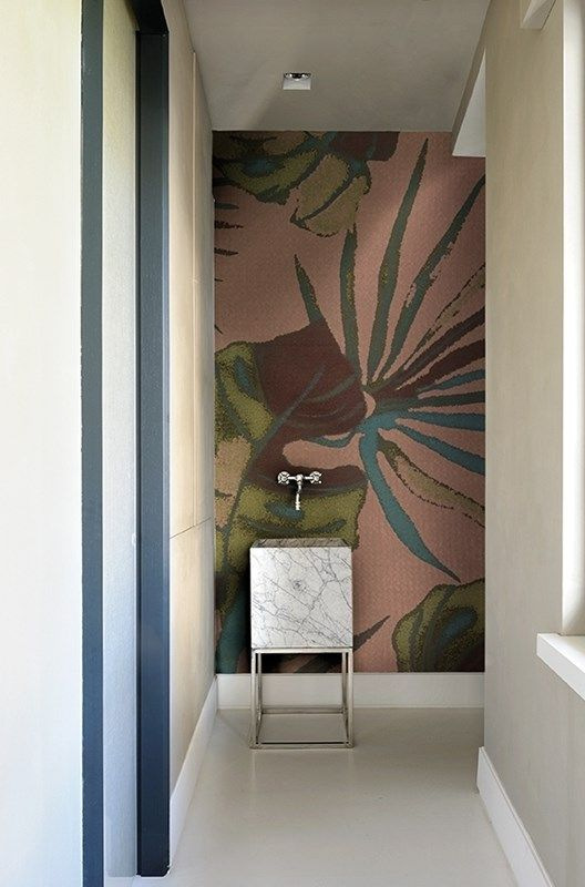 We love this tiny bathroom... The wallpaper is designed for bathrooms. Design by wallanddeco