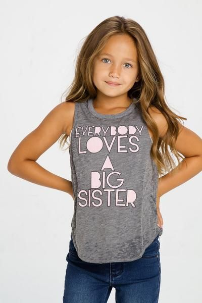 Everybody loves a big sister! Let her flaunt her big sister status in this adorable Chaser tank! Runs small.