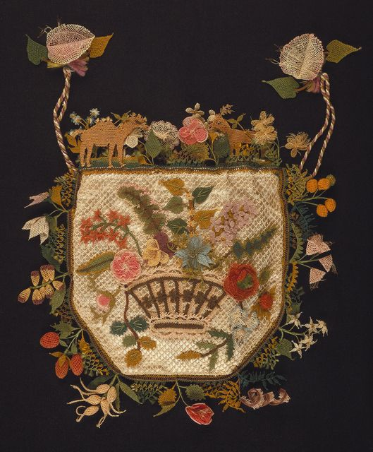 This flat purse with a drawstring top is an example of a type of needle knotting called oya, practiced in the Eastern Mediterranean. It is made from polychrome silks over white satin. One face has a bouquet of flowers, the other a basket of flowers. The sides and top are decorated with a deep edging of fruit, flowers, and animals, including a camel. This purse is medium: silk, wire technique: needle knotting called bebilla (english) or oya (turkish). Its dimensions are: H x W: 21 x 20 cm (8…