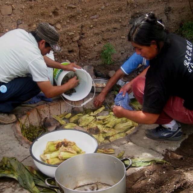 Peru: food prepared in corn husks & cooked in the earth. Heated up ground style.