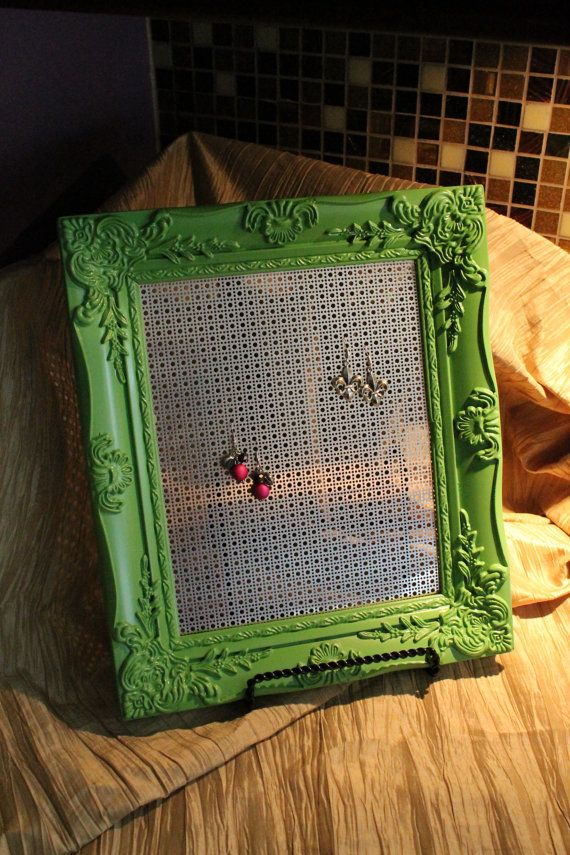 Buy a cheap frame from a second-hand store, paint it, & attach plastic needlepoint canvas to the back: Voila! A chic DIY earring holder! Makes a great gift.