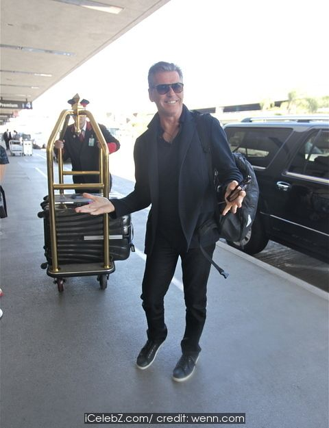 Pierce Brosnan At Los Angeles International Airport (LAX) http://icelebz.com/events/pierce_brosnan_at_los_angeles_international_airport_lax_/photo1.html