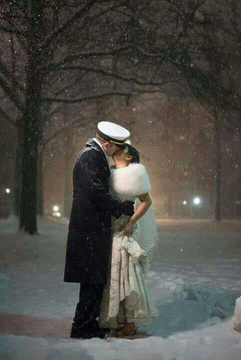 The kiss under falling snow.