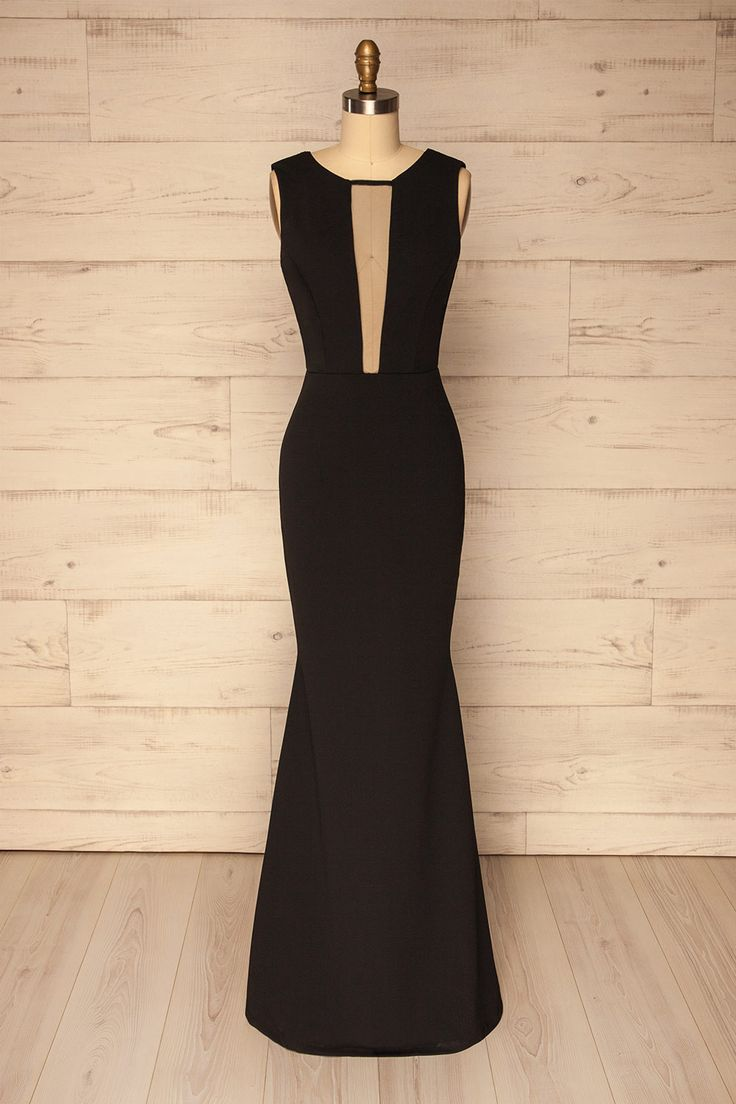Albidona #Boutique1861 / This long black gown will bring you back to the 1930's, giving you the allure of a starlet during the golden age of Hollywood! The form-fitting cut will show off your silhouette, while the stretch opaque fabric will keep you comfortable. The floor-length skirt flares slightly at the knees for a classic mermaid cut. A plunging neckline with black mesh inlay and open back reveal your skin, while two decorative straps drape in back for a touch of glamour. Invoke the…