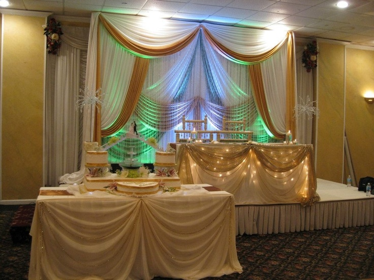 Wedding Ivory & Gold Backdrop with matching Sweetheart Table & Cake Table Decor by Adelisa Decor.