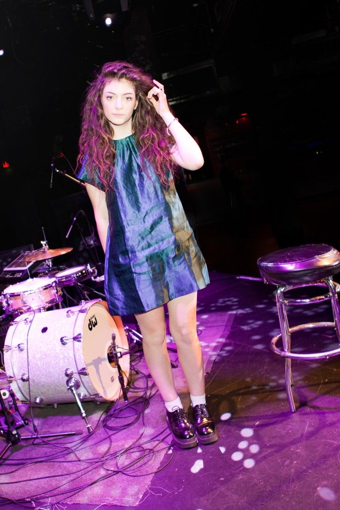 """Lorde, on stage style: """"A lot of long dresses, and I also have this obsession with disgustingly chunky sneakers and shoes. That's what stagewear is about for me—I've got to feel strong and feel like I can command attention."""" 
