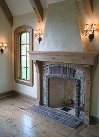 Nicely detailed fireplace (also love the arched window & soft light from the sconces)