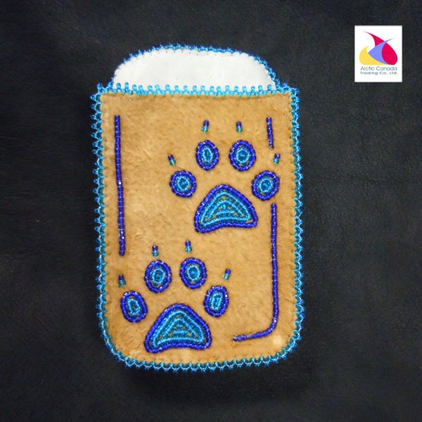 Hand made at the Acho Dene Native Craft store, this moose hide phone holder has intricate blue paw beading. Will fit most cell phones. 4