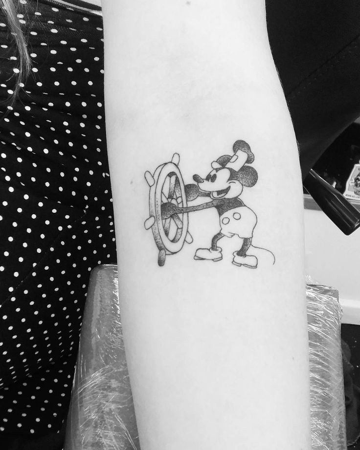 Classic Disney Steamboat Willie tattoo - Work by Amy Billing (Forever and Ever Bournemouth), photo Sian Venables. Subtle line and stipple shading.
